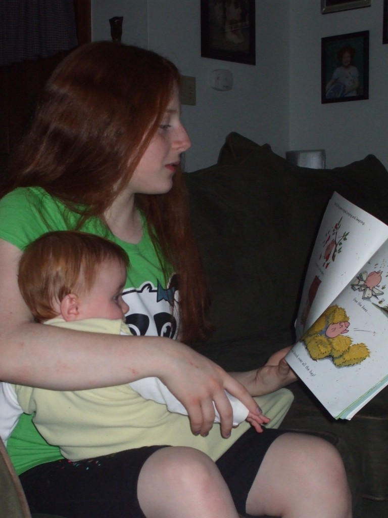 baby and sister reading