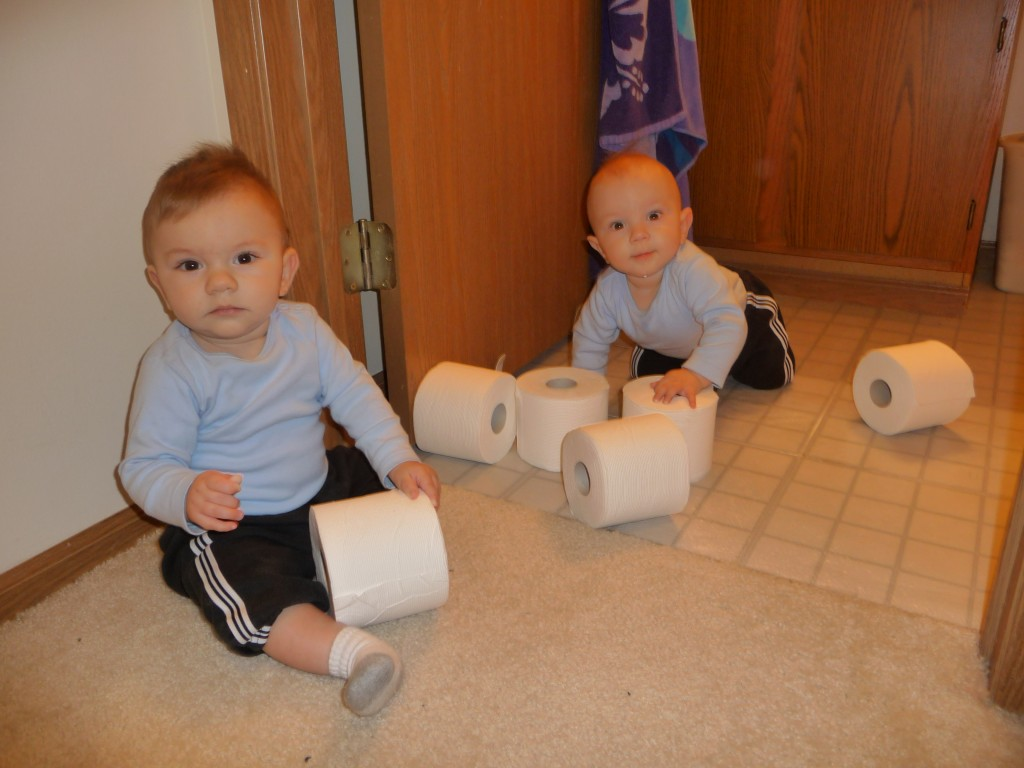 Gus and Jack with toilet paper rolls