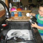 Everett helping with the dishes