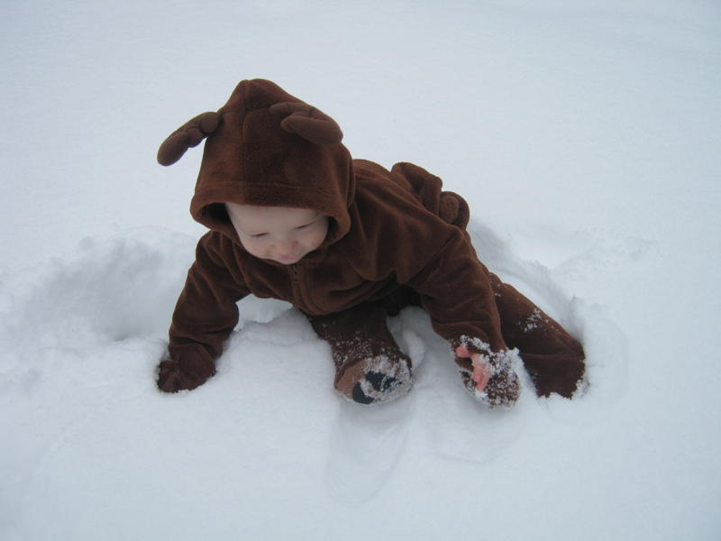 baby touching snow for the first time