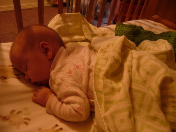Noele sleeping in her crib at two months.