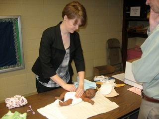 Rev. Caela Simmons Wood demonstrating a cloth diaper. Photo courtesy of http://earthbecomesme.wordpress.com/