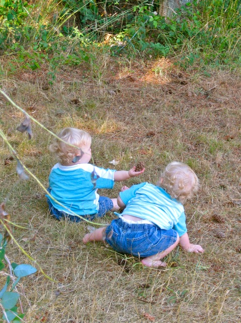 twins playing in the dirt