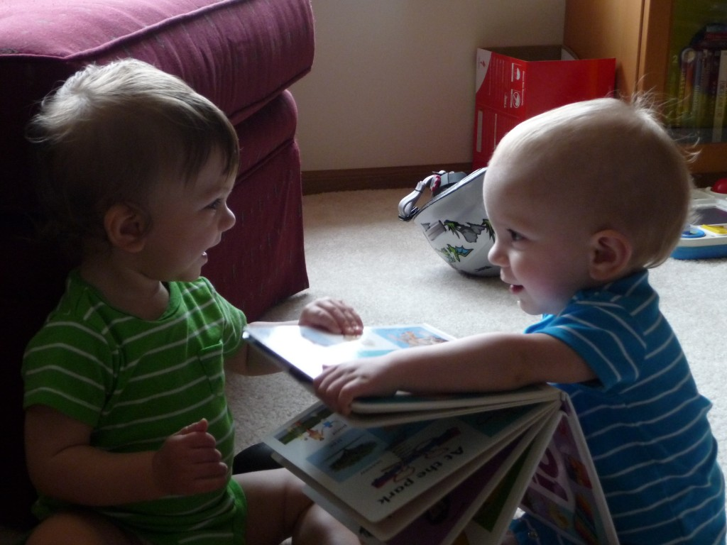 twins reading and smiling