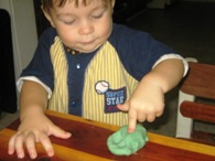 Kel poking playdough