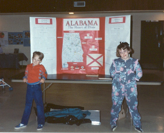 Kym and her brother presenting at a 1992 History and Science Fair.