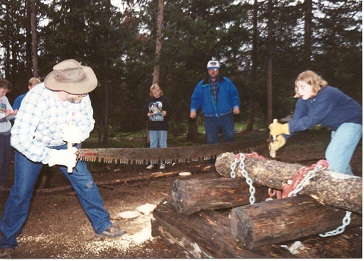 "Kym and her father in a 1997 ""Forestry Contest."" The project involved taking soil samples, sawing logs, and taking core samples from trees and various other things a forestry department might do. We counted it as part of our science (biology) curriculum."
