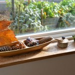 This low windowsill is great for strewing natural objects, sometimes interspersed with toys, too!