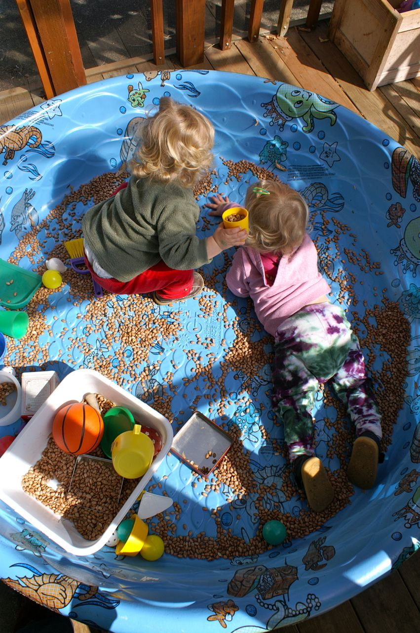 "Having fun in the ""bean pool"" out on our porch. You don't have to fill it up to have fun!"