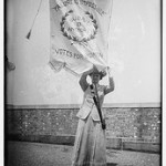 "Suffragist Florence Jaffray ""Daisy"" Harriman (1870-1967) holding a banner with the words ""Failure Is Impossible. Susan B. Anthony. Votes for Women."" Part of the George Grantham Bain Collection in the Library of Congress. (Source: Flickr Commons project, 2009"