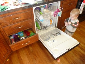boy and dishwasher