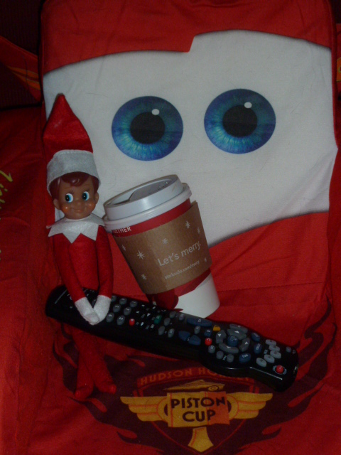 """Tom"" the Elf relaxes with the remote and some coffee!"