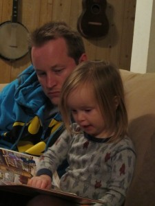 dad and girl reading book