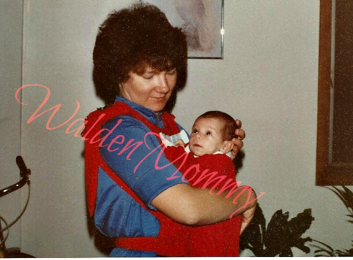 My mother wearing me in a handmade baby carrier 1979