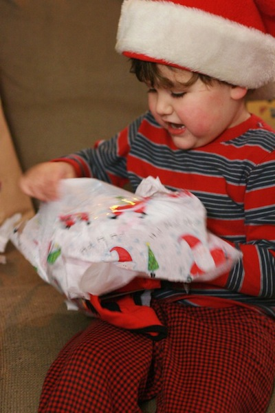 boy tears into wrapping paper on present