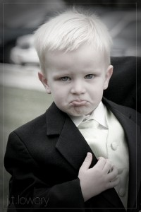 boy frowning in suit